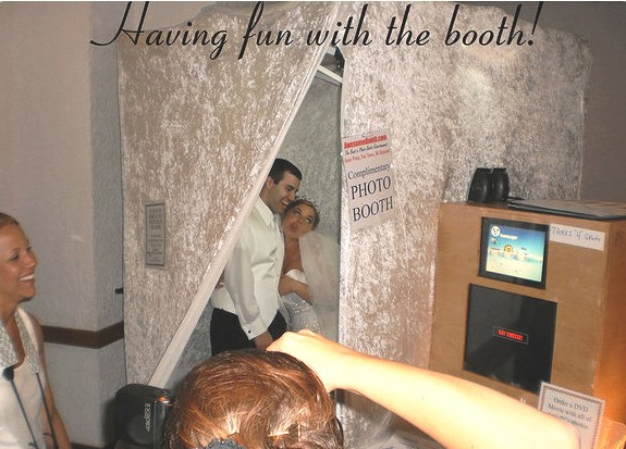 bride groom in photo booth rental detroit toledo ann arbor wedding having fun