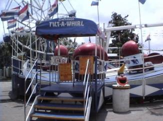 complete carnival midway rides and games tilt a whirl carnival ride public event tx